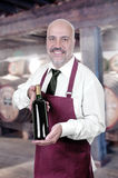 Sommelier Waiter with bottle of red wine. Isolated Stock Photo