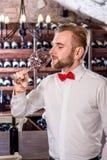 Sommelier in the wine cellar. Sommelier tasting wine in the wine cellar Royalty Free Stock Photography