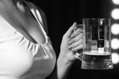 Sommelier woman with beer glass in hand. Near mirror with lamps, meeting and relax, bar and restaurant, tasting and degustation royalty free stock photos