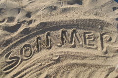 Sommer written in sand. The  german word sommer   written in the sand Stock Photos