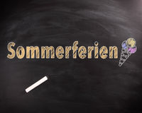 Sommerferien Text with Ice Cream on Chalkboard Royalty Free Stock Photo