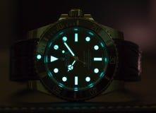 Sommergibilista di Rolex con incandescenza di superluminova Immagine Stock
