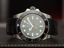 Sommergibilista di Rolex con incandescenza di superluminova Fotografia Stock