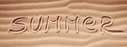Sommerhandschrift auf dem Sand Stockbilder