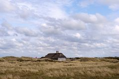 Sommerhouse in the dune. Sommerhouse and Danish flag in the dune a summer day stock image