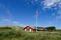 Sommerhus. A sommerhouse in Denmark with flagpole Royalty Free Stock Photos