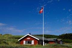Sommerhus with sky. A danish sommerhouse with blue sky and flagpole Royalty Free Stock Photos