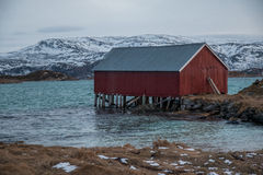 Sommeroya in Tromso, Norway. Red house in the seaside at Sommeroy nearby Tromso royalty free stock photos