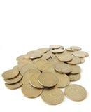 Sommige muntstukken op wit Stock Foto's