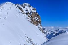 Sommità del Mt Titlis in Svizzera un giorno di inverno ventoso Fotografia Stock Libera da Diritti