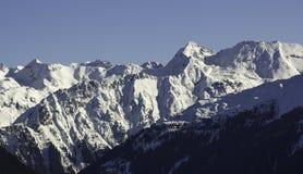 Sommità di inverno nelle alpi Immagini Stock Libere da Diritti