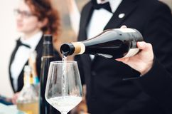Sommlier serving a glass of sparkling wine in Alba Piedmont, Italy royalty free stock images