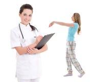 Somnambulism - young female doctor with sleepwalking girl isolat Stock Photography