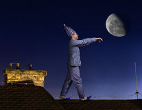 Somnambulist on the roof. Somnambulist walking on the roof Royalty Free Stock Photos