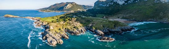 Somo Surfspot Spain Vanlife. This is the beach of Sonabia at the north coast of Spain close to Bilbao. You see the atlantic ocean from the top and some waves stock photo