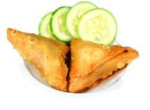 Somocha with Salad. Spicy somocha over white background Stock Image