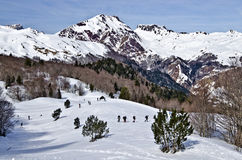 Somport Pass for cross country ski and winter hiking activity. Somport pass in French Atlantic Pyrenees panorama, people skiing and snowshoeing are down by the royalty free stock photos