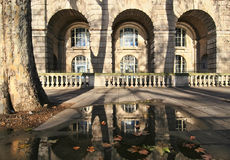 Somserset House. London: Detail of Somerset House and reflection in pool of rainwater with autumn leaves stock photos