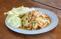 SomTam, Green papaya salad Thai cuisine spicy delicious on woode. N plate with copy space Stock Photo