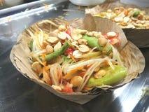 Somtam Papaya Salad in banana leaf krathong Stock Images