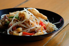 Somtam (Papaya Salad) with pork crackling. Photo of Somtam (Papaya Salad) with pork crackling stock image