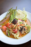 Somtam. Popular Thai spicy papaya salad or Somtam with fresh vegetable Stock Image