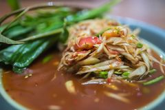 Somtum, papaya salad, famous Thai food close up with stricky rice.  royalty free stock photo
