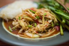 Somtum, papaya salad, famous Thai food close up with stricky rice.  royalty free stock image