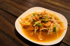 Somtum, papaya salad with shrimp, spicy Thai food dish.  Stock Photo