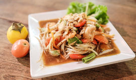 Somtum, papaya salad with shrimp, spicy Thai food dish. Selective focus on shrimp Stock Photos
