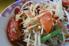 Somtum, spicy Asian food is popular with colorful papaya.  royalty free stock photography