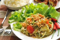 Somtum Thai food. And spicy food on a white dish Royalty Free Stock Photography