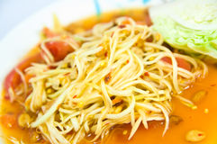 Somtum Thai food. And spicy food on a white dish Stock Images