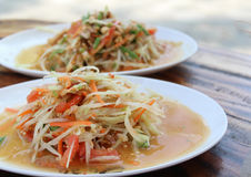 Somtum. Thai food and spicy food on a white dish Royalty Free Stock Photo