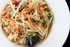 Somtum Thai. Noodles and Papaya Spicy Salad Somtum, Thai food on white dish Royalty Free Stock Photos