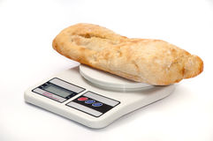 Somun bun and a rolling pin on the kitchen digital scale.  stock photo