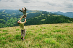 Son. On father hand in mountain royalty free stock photography