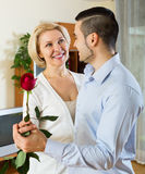 Son asking  mother to dance at home Royalty Free Stock Image