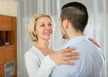 Son asking  mother to dance at home. Adult son asking happy mother to dance at home Stock Photography