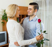 Son asking mother to dance at home. Adult son asking senior mother to dance at home stock photography