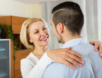 Son asking  mother to dance at home Stock Photos