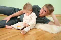 Son with book and father Royalty Free Stock Photo