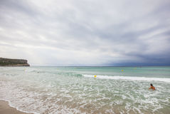 Son Bou beach at noon, on a clody day, south of Minorca, Menorca, Balearic Islands, Spain. Cloudy day in the middle of summer, but with very few people on the royalty free stock images