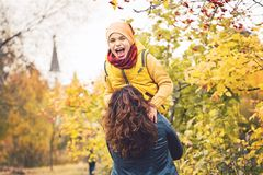 Son child boy playing and hugging with his mother. Outdoors. Happy loving family Royalty Free Stock Photo