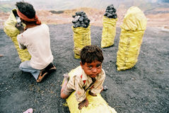 Son of the coal worker, India. People packing coking coal to the market, Jharia, Jarkhand, India Stock Images