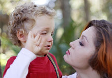 Son crying mother comforting. A walk Royalty Free Stock Images