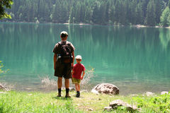 Son and dad. Son and father together by the lake. Dad holding son by the hand Stock Image