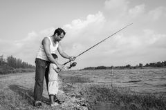 Son and dad fishing at river Stock Image