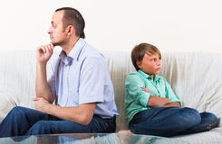 Son and dad having domestic quarrel. Son and offended dad having domestic quarrel Stock Photo