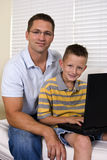 Son and Dad Laptop Royalty Free Stock Photos